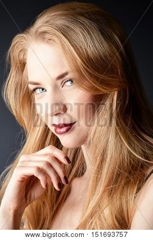 Portrait of a gorgeous blonde woman with sensual maroon lips. Beauty, fashion. Make-up, cosmetics.