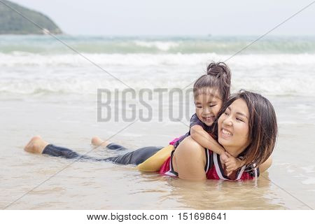 Mum And Children Play On Sea
