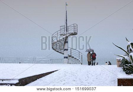 Cecina Marina Livorno Tuscany - snowfall in the seaside town the iron staircase in Via della Vittoria