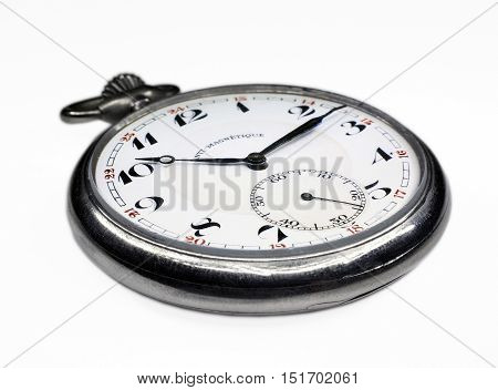 Old swiss pocket watch close up perspective left isolated on white background