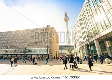BERLIN GERMANY - 4 MARCH 2016: local people and tourists walking at Alexanderplatz in central Mitte district of capital city with tv tower known as