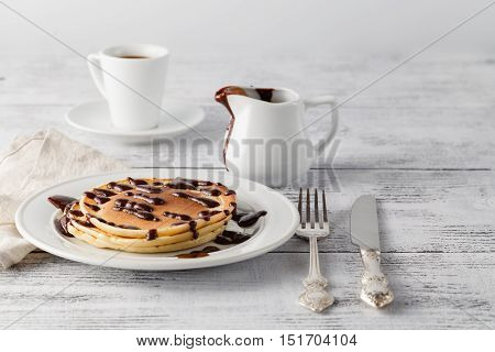 Sweet pancakes with chocolate and coffee cup