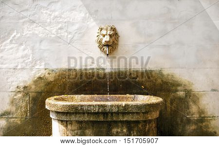 Ancient fountain with lion head ancient architecture