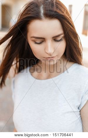 Modest Beautiful Girl Looks Down. Portrait Of A Pretty Woman In A Summer Sunny Day
