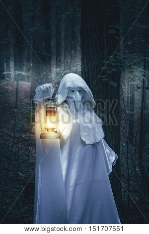Figure In White Robe With Lantern.
