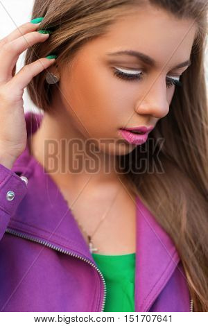 Bright Color Portrait Of A Beautiful Woman With Pink Lips And A Jacket On A Summer Day