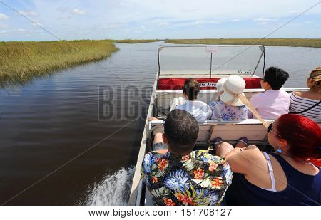 EVERGLADES FLORIDA USA - APRIL 30 2016: Tourists on a boat tour through the Everglades swamp in Florida