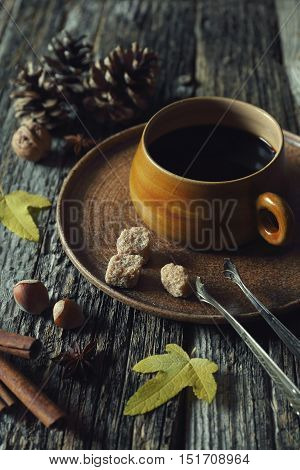Autumn mood: cup of coffee nuts and autumn leaves. Toned image