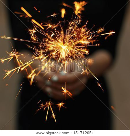 Amazing sparklers in female hands. Beautiful sparks