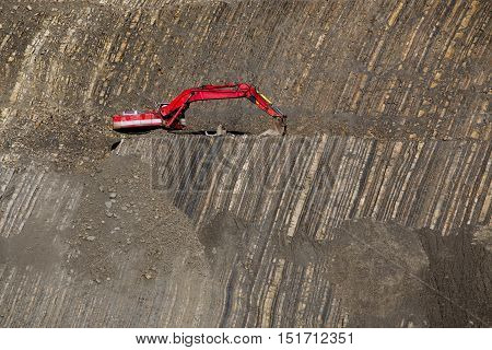Red Digger In Stone-pit