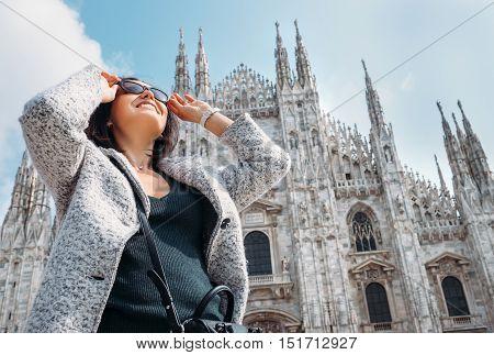 Woman in sun eye glasses stay near Doumo di Milano