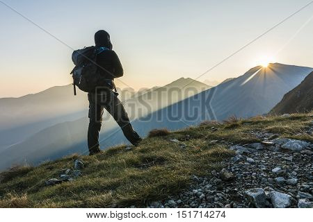 Hiker With Backpack In The Morning In The Mountains.