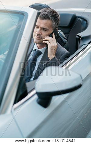 Businessman Driving And Phone Calling