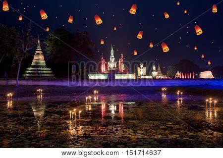 Buddha Statue at Wat Mahathat in Sukhothai Historical Park with lantern in loy krathong day at Sukhothai Thailand.