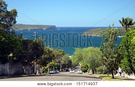 Sydney Australia - March 30 2013. Awaba Street directing to Balmoral beach. Entrance of Sydney Harbour with North Head and South Head in the background.