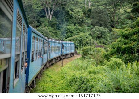 Blured train from Nuwara Eliya to Kandy among tea plantations in the highlands of Sri Lanka