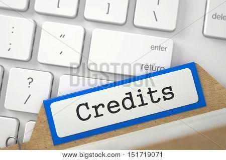 Credits written on Blue Folder Index Overlies Modern Metallic Keyboard. Closeup View. Blurred Image. 3D Rendering.