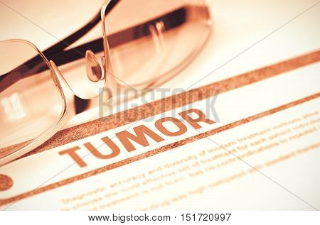 Tumor - Printed Diagnosis with Blurred Text on Red Background with Specs. Medicine Concept. Tumor - Medical Concept on Red Background with Blurred Text and Composition of Eyeglasses. 3D Rendering.