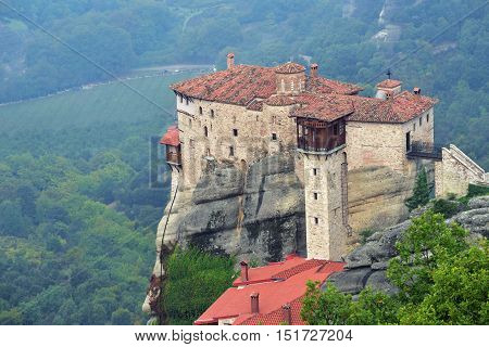 View from above on the Monastery Roussanov at sunrise Meteora Greece