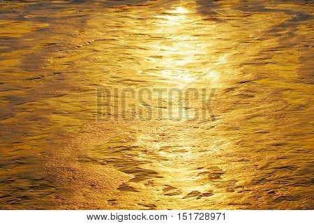 Golden water in the sun rise over the Atlantic ocean in Flagler Beach, Florida