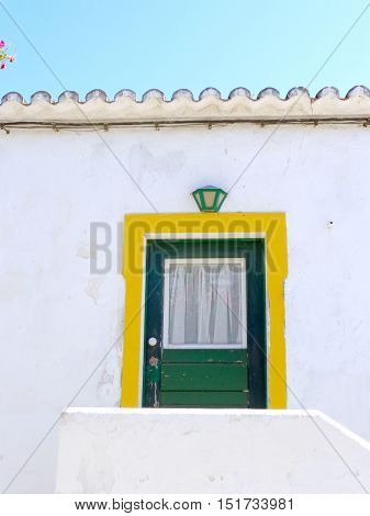 colorful door in a typical Portugese house situated in Cacela Velha