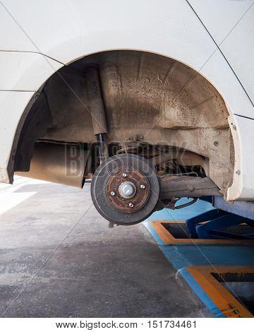 Rear wheel drum brake maintenance job in progress.