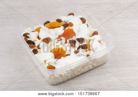 Cottage Cheese With Dried Apricots, Raisins And Yoghurt In Container
