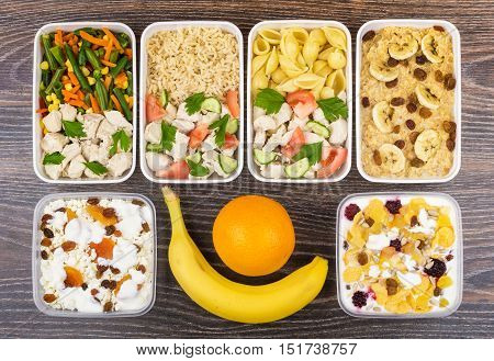 Ration Of Balanced Food In Plastic Containers On Dark Table