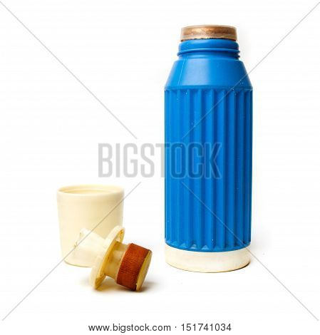 Blue thermos bottle from the 1960s made in West Germany. Isolated on white background.