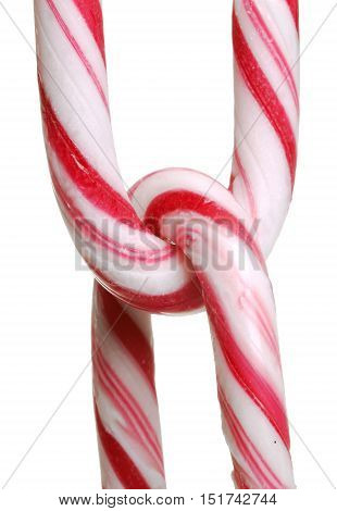 Chain of candy canes isolated on white background