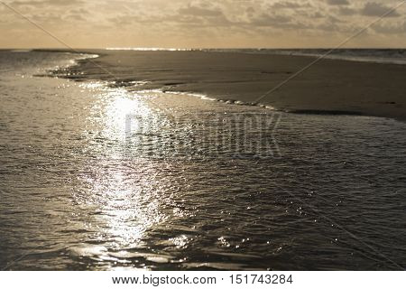 Sun rays on the North Sea Beach of the Wadden Island Vlieland