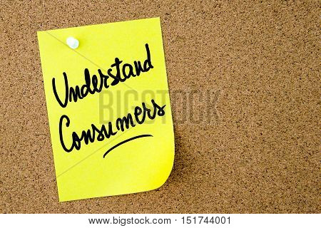 Understand Consumers Text Written On Yellow Paper Note