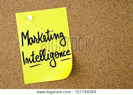 Marketing Intelligence Text Written On Yellow Paper Note