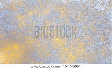 Grey fiber fabric and yellow glitter film, background