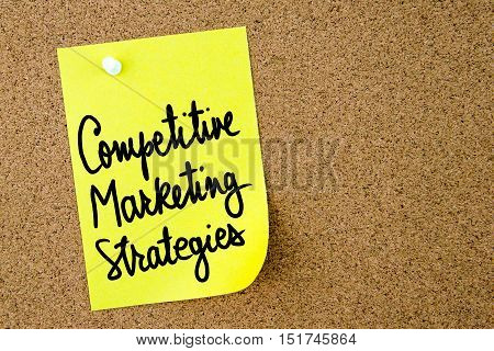 Competitive Marketing Strategies Text Written On Yellow Paper Note
