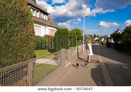 Woman With Two Dogs.