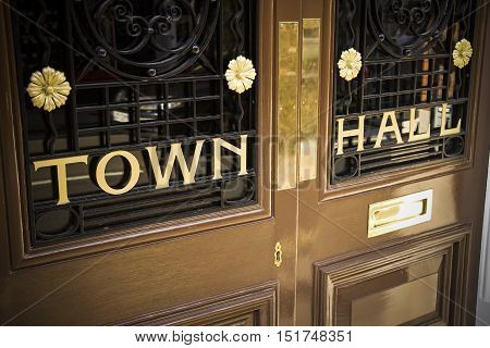 Town hall with shiny metallic lettering at entrance to local government offices