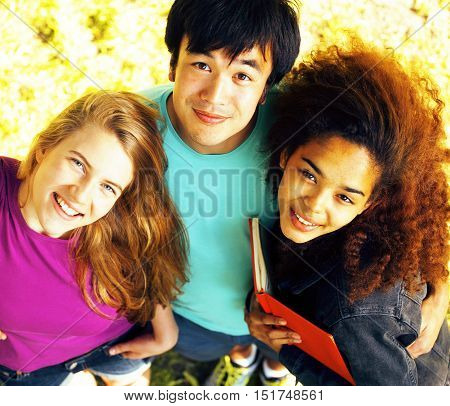 portrait of international group of students close up smiling, blond girl, asian boy, young african woman