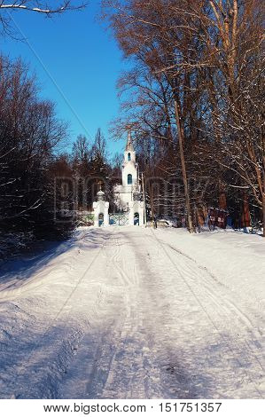 sun day church in the winter forest