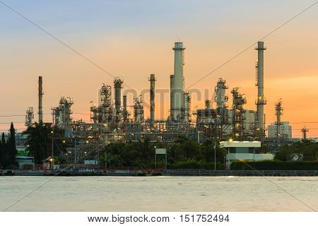 Sunrise over Oil refinery river front, Bangkok Thailand