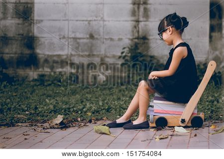 pictures Vintage style little girl sitting on stack of books