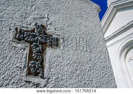 Closeup of cross on tomb in cemetery in Spanish colonial town in Guatemala, Central America