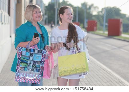 woman shopping in summer outdoor in a sunny day