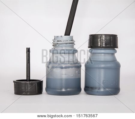 Ink bottles isolated on the white background