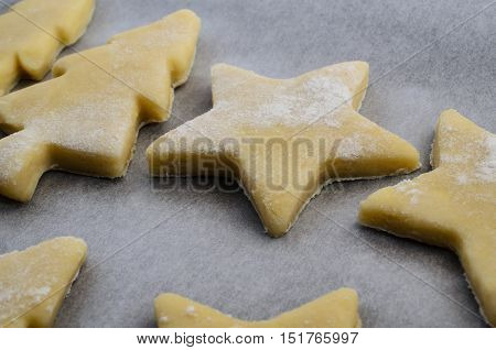 Christmas Biscuit Shapes In Raw Cookie Dough
