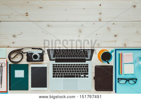 Creative contemporary desktop with laptop digital tablet camera and office supplies flat lay banner with copy space