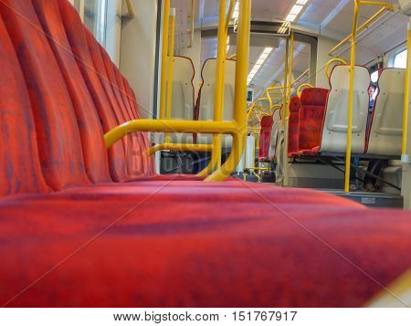 Rows of red seats in Warsaw's commuter trains
