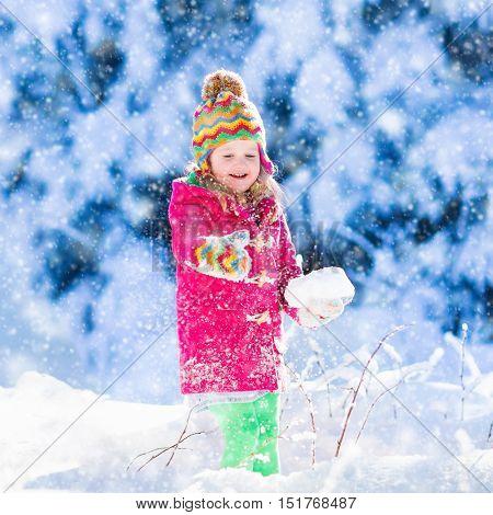 Child Having Fun In Snowy Winter Park