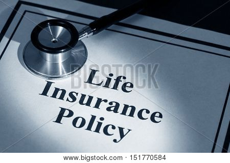 stethoscope and life insurance policy business concept