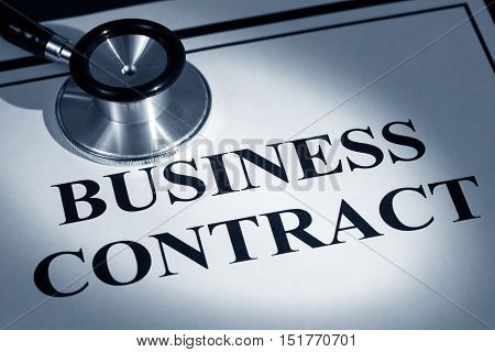 stethoscope and business contract concept of contract issue
